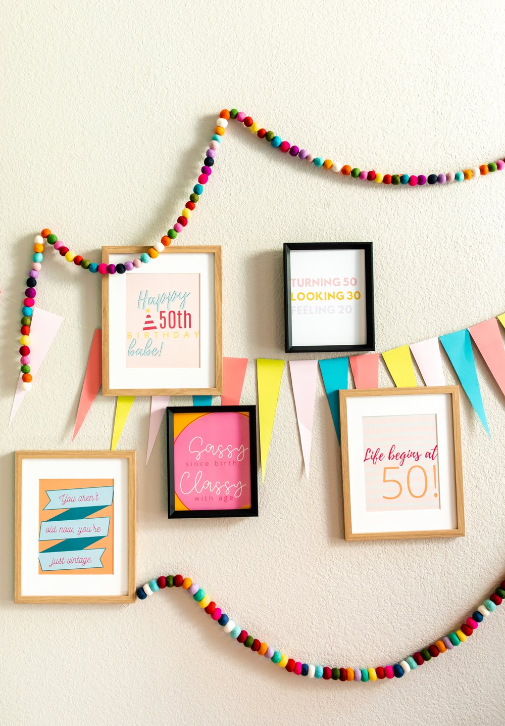Hosting a 50th birthday party signs and quotes decor